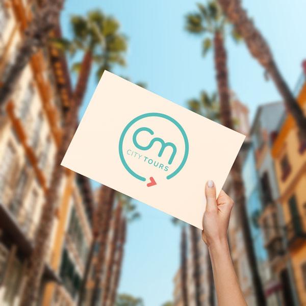 Cartel de CM City Tours en el Meeting Point